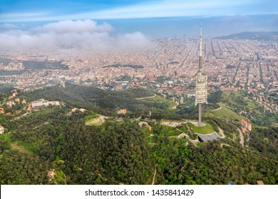 Barcelona aerial wide angle view from the hills above the city, Spain. Clouds below the horizon