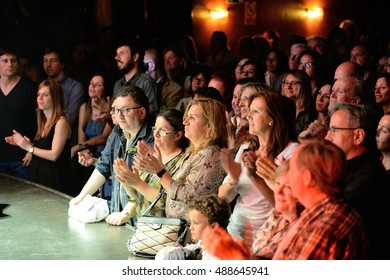 BARCELONA - APR 16: The audience clapping in a concert at Luz de Gas club on April 16, 2015 in Barcelona, Spain.
