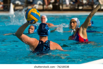 BARCELONA - APRIL 10: Unidentified water polo players in action during the women Spanish league match between CN Mataro and Sant Andreu, final score 4 - 7. April 10, 2011 in Mataro (Spain).