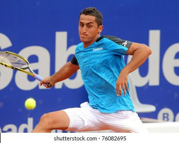 BARCELONA - APRIL 19: Spanish tennis player Nicolas Almagro in action during his match against Pablo Andujar of Barcelona tennis tournament Conde de Godo on April 19, 2011 in Barcelona