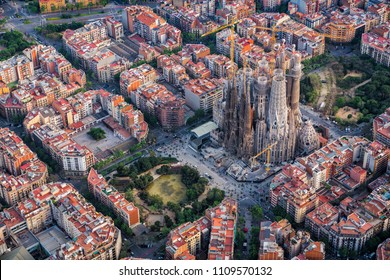 BARCELONA - APRIL, 2018 : Barcelona aerial view, Eixample residencial district and Sagrada familia, Spain. Designed by Catalan architect Antoni Gaudi