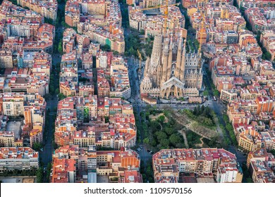 BARCELONA - APRIL, 2018 : Aerial view of Eixample residencial district and Sagrada Familia Basilica, Barcelona, Spain. Designed by Catalan architect Antoni Gaudi