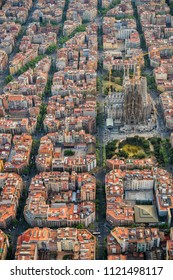 BARCELONA - APRIL, 2018 : Barcelona aerial view, Eixample residencial district and Sagrada Familia Basilica, Spain. Designed by Catalan architect Antoni Gaudi