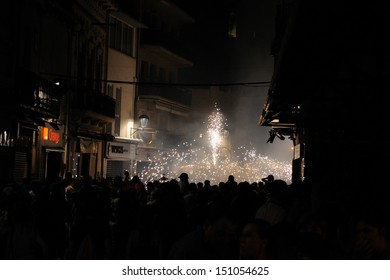 BARCELONA - AUG 17: Fire devils in the Fire-Run (Correfoc) as part of the Mollet estival party (festa major) on August 17, 2013 in Mollet del Valles, Barcelona, Spain.
