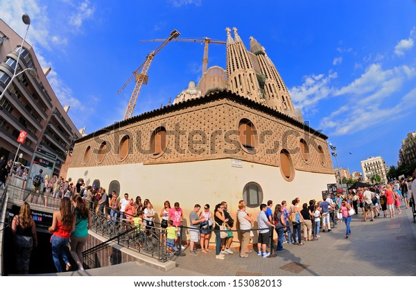 BARCELONA - AUG 29: Tourists queue to buy tickets to visit the interior of The Sagrada Familia on August 29, 2013 in Barcelona, Spain.