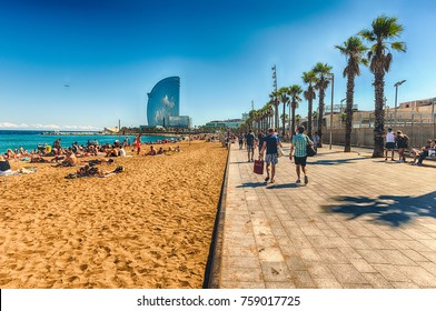 BARCELONA - AUGUST 10: People enjoying a sunny day on La Barceloneta beach, Barcelona, Catalonia, Spain, on August 10, 2017