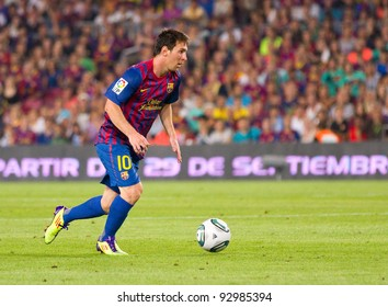 BARCELONA - AUGUST 17: Leo Messi in action during the Spanish Super Cup final match between FC Barcelona and Real Madrid, final score 3 - 2, on August 17, 2011 in Camp Nou stadium, Barcelona, Spain.