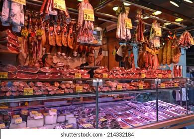 Barcelona - August 21: a meat stall at the historical La Boqueria market in Barcelona, Spain on August 21, 2014. The market is one of the main tourist attractions in the city.