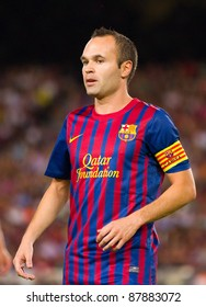BARCELONA - AUGUST 22: Andres Iniesta in action during the Gamper Trophy final match between FC Barcelona and Napoli, final score 5 - 0, on August 22, 2011 in Camp Nou stadium, Barcelona, Spain.