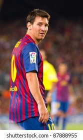 BARCELONA - AUGUST 22: Leo Messi in action during the Gamper Trophy final match between FC Barcelona and Napoli, final score 5 - 0, on August 22, 2011 in Camp Nou stadium, Barcelona, Spain.