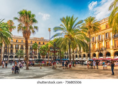 BARCELONA - AUGUST 8: People waking in Placa Reial, scenic sightseeing and iconic square of the Gothic Quarter in Barcelona, Catalonia, Spain, on August 8, 2017