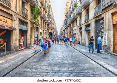 BARCELONA - AUGUST 8: People waking in Carrer de Ferran, scenic street of the Gothic Quarter in Barcelona, Catalonia, Spain, on August 8, 2017