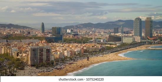 Barcelona beach on morning sunrise with Barcelona city and sea