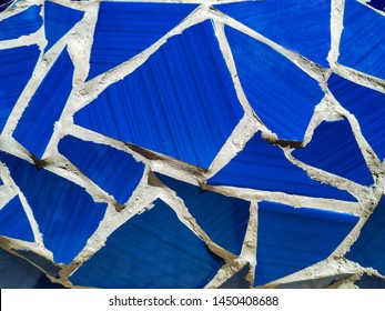 Barcelona. Blue mosaic wall decorative ornament from ceramic broken tile. Background, copy space.