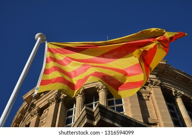 Barcelona, Catalonia, Spain / 03-17-2017  A Catalan flag waving in front of a building in Barcelona.
