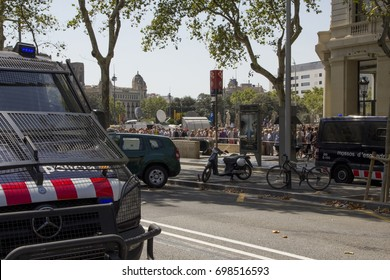 BARCELONA, CATALONIA, SPAIN - AUGUST, 18, 2017. TERRORIST ATTACK. Rambla Catalunya closed to transit. People trying to enter to Plaça Catalunya at the silence minute for the victims of the attack.