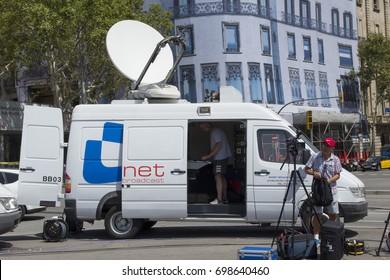 BARCELONA, CATALONIA, SPAIN - AUGUST, 18, 2017. TERRORIST ATTACK. International journalists covering the news. Press van, broadcast live.