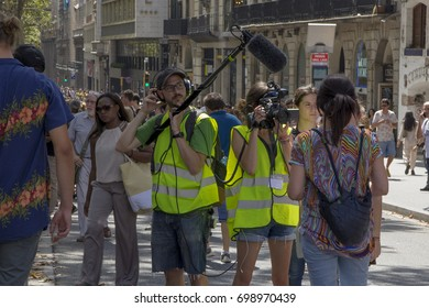 BARCELONA, CATALONIA, SPAIN - AUGUST, 18, 2017. Terrorist Attack. Journalist at the Barcelona's Ramblas, one day after the attack, doing an interview.