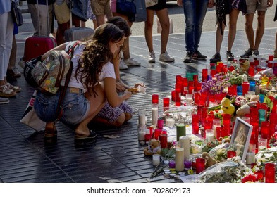 BARCELONA, CATALONIA, SPAIN - AUGUST, 24, 2017. Crowd gathers at the Ramblas of Catalonia and gives their tributes and prayers to the victims of Barcelona terrorism attack of 17 August 2017.