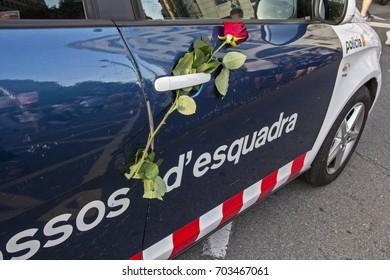 "Barcelona, Catalonia, Spain - August, 26,2017. Crowd manifesting at plaza catalunya ""I'm not afraid"" . Manifestation for terrorist attacks. Rose police car."