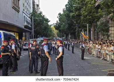 "Barcelona, Catalonia, Spain - August, 26,2017. Crowd manifesting at plaza catalunya ""I'm not afraid"" . Manifestation for terrorist attacks. Police device at city center. Mossos d'esquadra."
