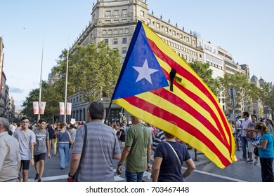 "Barcelona, Catalonia, Spain - August, 26,2017. Crowd manifesting at plaza catalunya ""I'm not afraid"" . Manifestation for terrorist attacks. Independentist catalan flag."