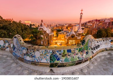 Barcelona, Catalonia, Spain - December 12, 2016: Park Guell with city skyline behind at sunset