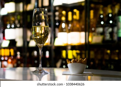 BARCELONA, CATALONIA, SPAIN - FEBRUARY 26, 2018: White Cava sparkling wine glass in a tasting in a wine shop placed in an historic building in Barcelona city center