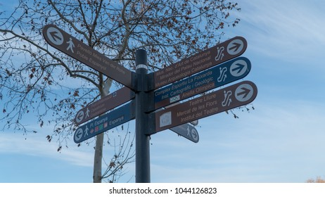 Barcelona, Catalonia, Spain - January 14th, 2018: Barcelona tourist street sign pointing directions to Poble Espanyol, Placa Espanya, National Art Museum, Archaeological Museum of Catalonia and others