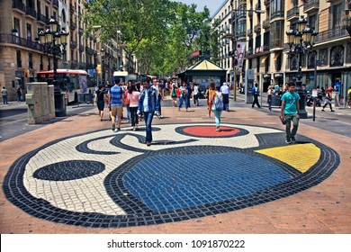 "BARCELONA, CATALONIA, SPAIN- June 12, 2016. A ""mosaic"" by Joan Miro at La Ramba, the most famous street of the city."