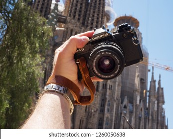 Barcelona, Catalonia, Spain - June 12, 2018: Taking a selfie on an old film camera