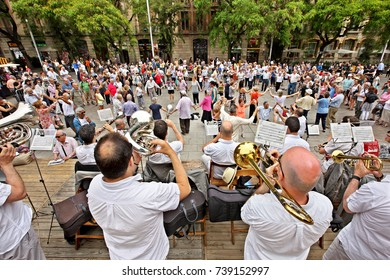 """BARCELONA, CATALONIA, SPAIN- June 12, 2016. Hundreds of Catalan citizens gather every Sunday noon outside of the Cathedral of Barcelona, to dance the Sardana, the """"national"""" dance of Catalunya."""