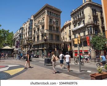 Barcelona, Catalonia, Spain - June 20, 2017: People on Miro mosaic on La Rambla (Las Ramblas) boulevard