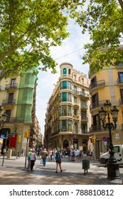 Barcelona, Catalonia, Spain - JUNE, 2016. The view from the famous Las Ramblas in Barcelona in the summer. Tourists walking along The most popular street La Rambla. Vertical image