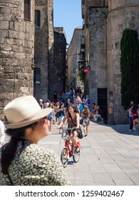 Barcelona, Catalonia, Spain - June 21, 2017: Tourists in the Gothic Quarter