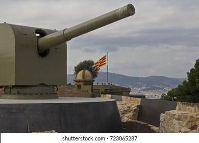 Barcelona, Catalonia, Spain. Montjuic. Old historic military tank with a catalan flag-raising in the background.
