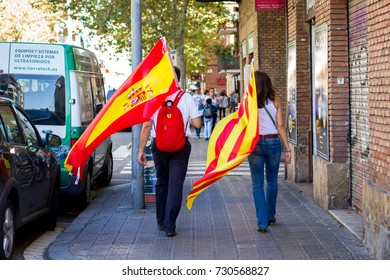 BARCELONA, CATALONIA, SPAIN - October 08, 2017: Protesters rally (demonstration) against Catalan independence in Barcelona, peoples with spanish and catalan flags.