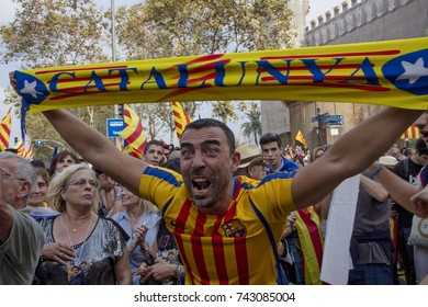 Barcelona, Catalonia, Spain - October, 27, 2017. Passeig de Pujades street. Man celebrating independence in the moment of the declaration of the Catalonia Republic. Barça T-shirt with Catalonia flag.