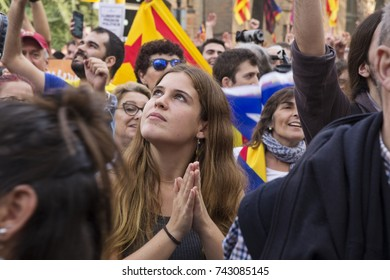 Barcelona, Catalonia, Spain - October, 27, 2017. Pujades street. Crowd of  people celebrating independence in the moment of the proclamation of the Catalonia Republic. Young woman.