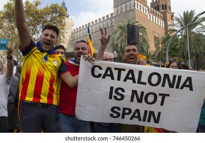 Barcelona, Catalonia, Spain - October, 27, 2017. Group of men with a banner in Pujades street yelling independence in the moment of the declaration of the Catalonia Republic.