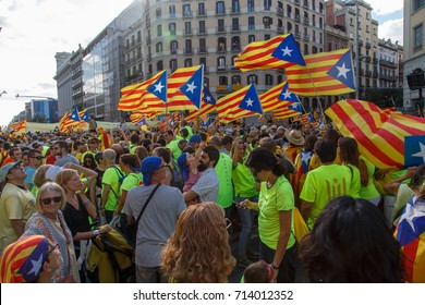 Barcelona, Catalonia, Spain, September 11, 2017: People on street on riot during national day from Catalonia claming for independence of Catalunya in Barcelona with catalan flags. Editorial caption