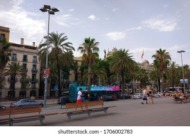 Barcelona, Catalonia/Spain - 07 17 2018: people walking in the center of Barcelona, tourist bus with passengers.