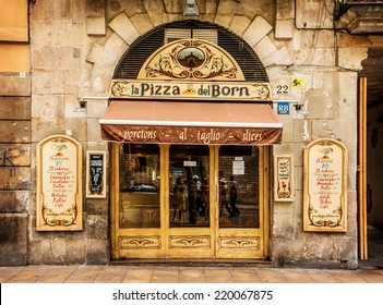 BARCELONA, CATALONIA/SPAIN - AUGUST 19: Old building facade and restaurant entrance with beautiful handmade signboards. August 19, 2014 in Barcelona, Spain.