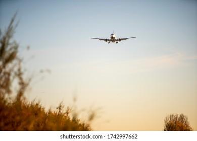BARCELONA, CATALUNYA, SPAIN - DECEMBER 13, 2017: Ryanair plane landing at El Prat airport, Barcelona.