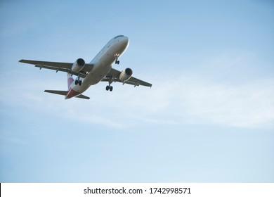 BARCELONA, CATALUNYA, SPAIN - DECEMBER 13, 2017: Iberia plane landing at El Prat airport, Barcelona.