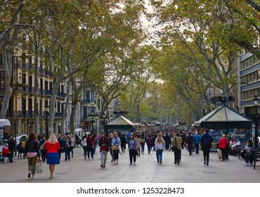 BARCELONA, CATALUNYA, SPAIN - November 16, 2018: Thousands of people walk daily through this famous pedestrian area, known as La Rambla