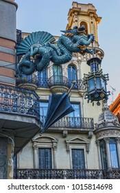 Barcelona. Chinese dragon on House of Umbrellas (Casa Bruno Cuadros) building on La Rambla. Catalonia, Spain.