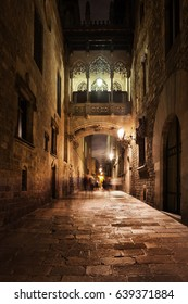 Barcelona city by night, Gothic Quarter (Barri Gotic), Bishop Bridge (Pont del Bisbe) crossing Carrer del Bisbe street, Catalonia, Spain, Europe