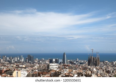 Barcelona city with mediterranean sea on background