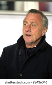 BARCELONA - DEC 30: Catalonia coach Johan Cruyff on the bench during the friendly match between Catalonia vs Tunisia at Olympic Stadium in Barcelona, Spain on Dec. 30, 2011